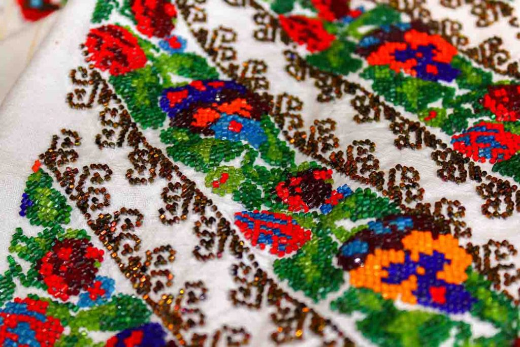 Romanian Peasant Blouses With Beaded Floral Patterns