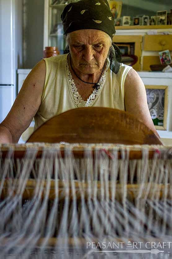 Traditional Textile Weaving Demonstration in Romanian Village of Straja
